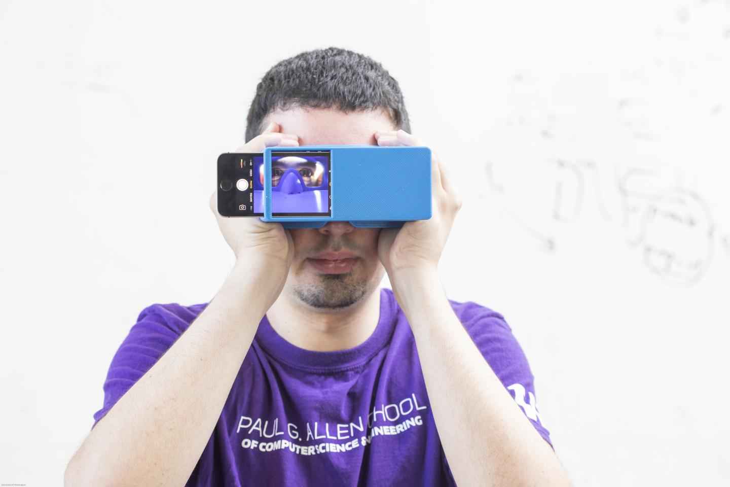 BiliScreen is a new smartphone app that can screen for pancreatic cancer by having users snap a selfie. It's shown here with a 3D printed box that helps control lighting conditions to detect signs of jaundice in a person's eye. [Dennis Wise/University of Washington]