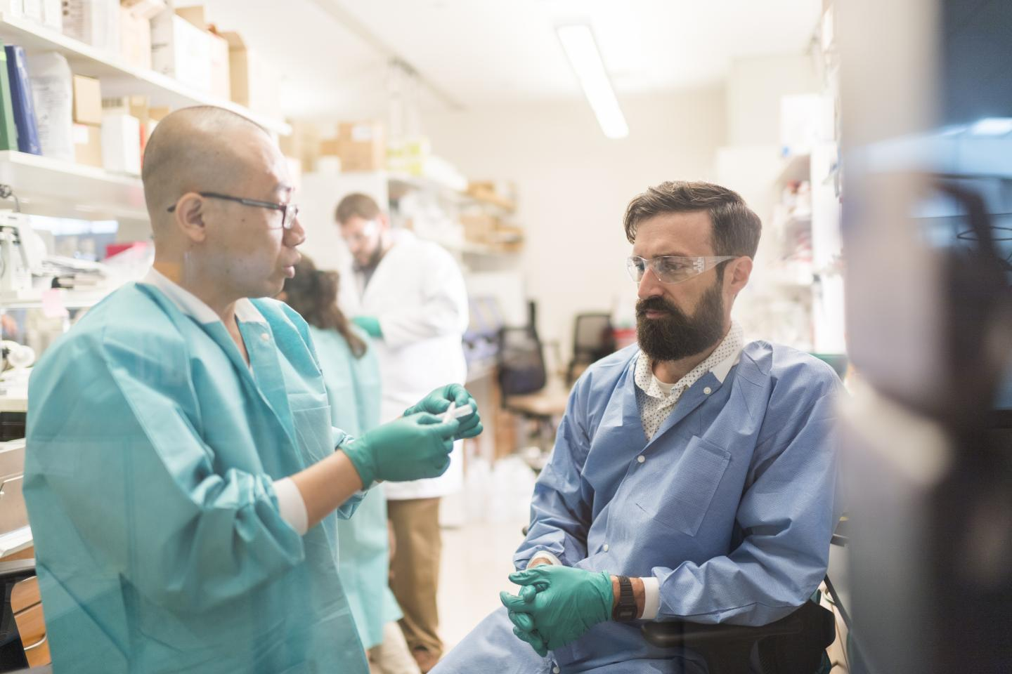Morgridge Institute Regenerative biology researchers Jue Zhang and Matt Brown examine a part for a new bioreactor designed to help grow arterial tissue. [The Morgridge Institute for Research]