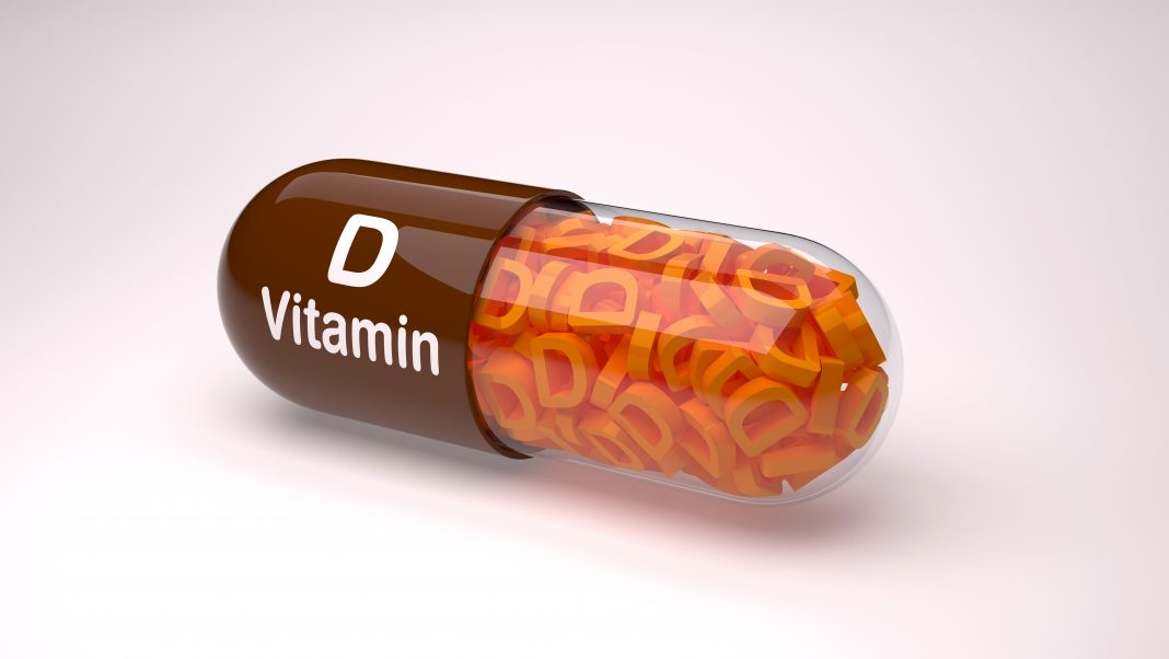 Brown pill or capsule filled with vitamin D.