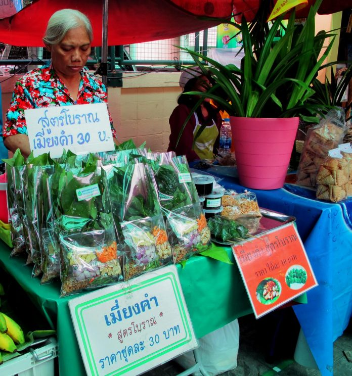 Woman selling vegetable snacks in a Thai market—a possible source of probiotic Bacillus spores. [NIAID]