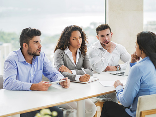 Business people having a job interview for new staff member.