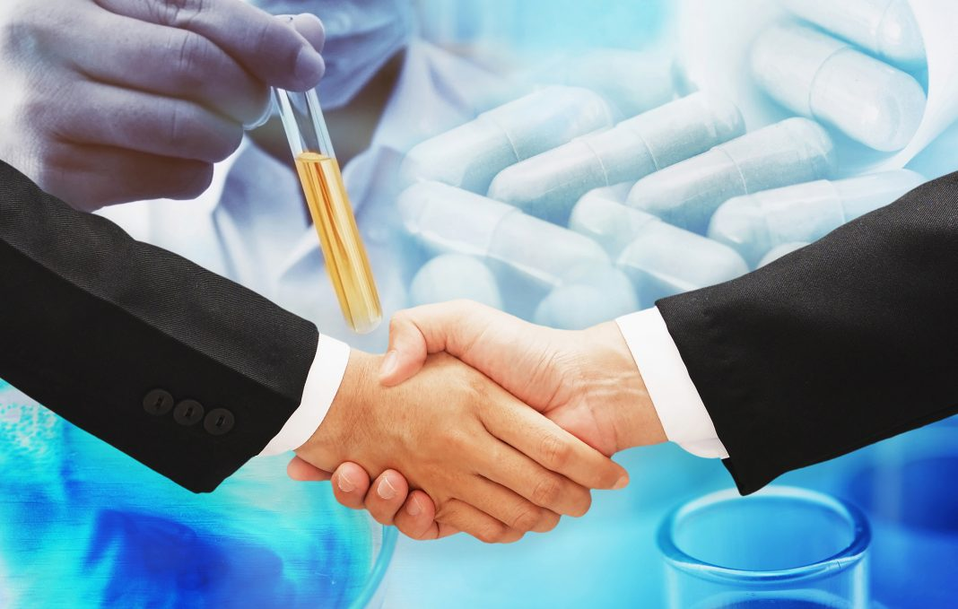 business man hand shake with science research blur background