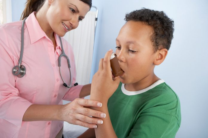 nurse and boy with inhaler