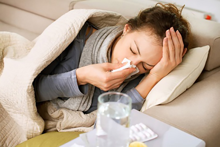 woman sick on couch
