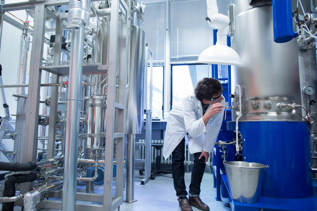 Man in lab with fermenter
