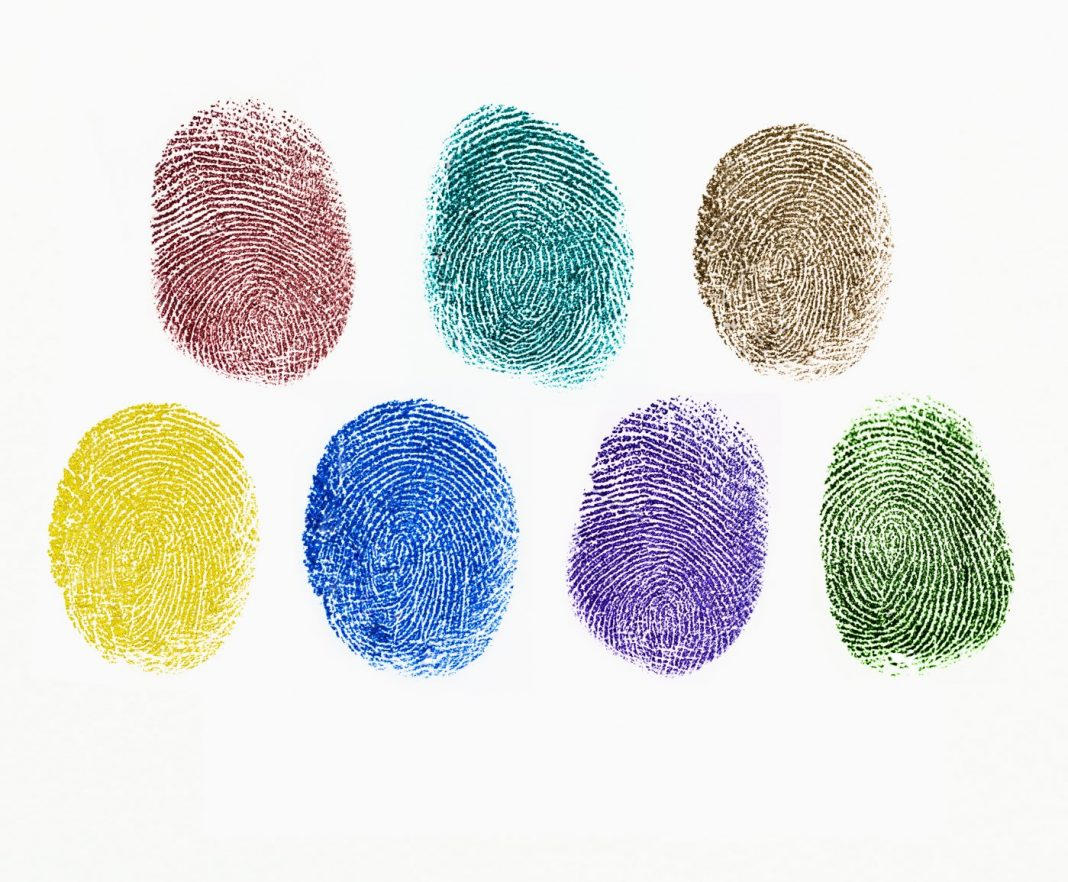 Close up of colorful fingerprints on white background