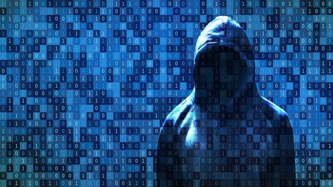 Hacker standing in front of 01 or binary numbers