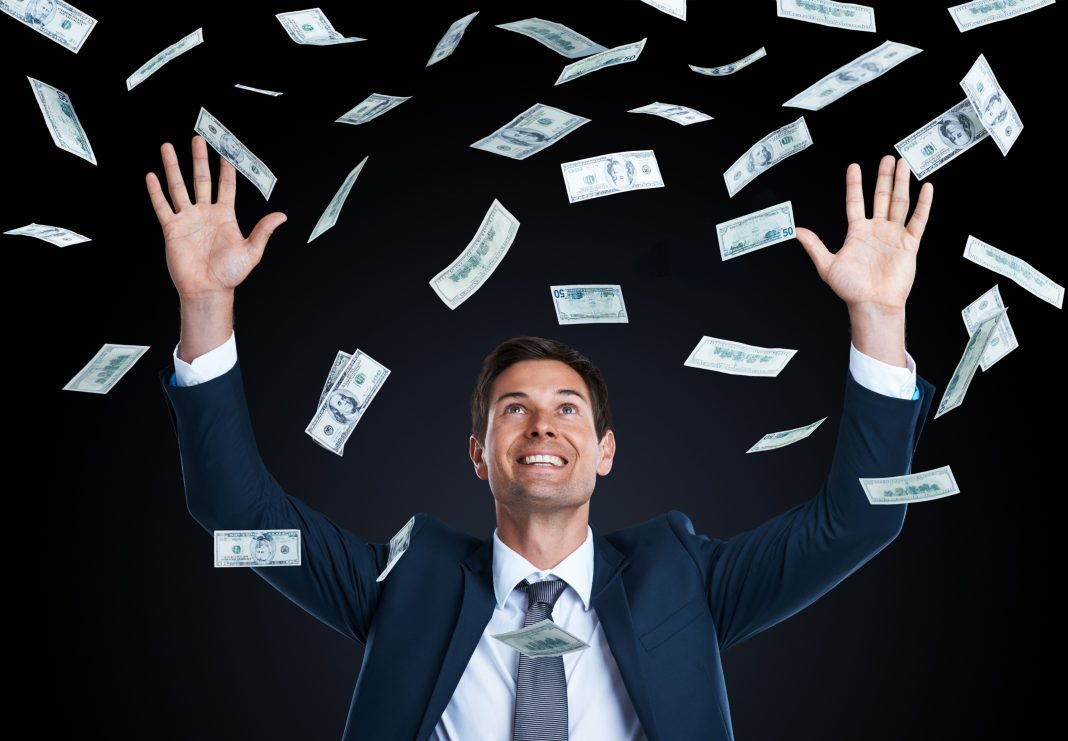 raining money on businessman