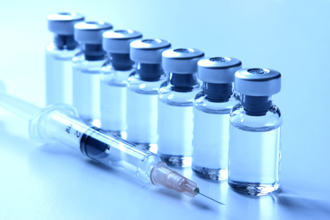 Medical Vials and a Syringe - Vaccination Concepts Series