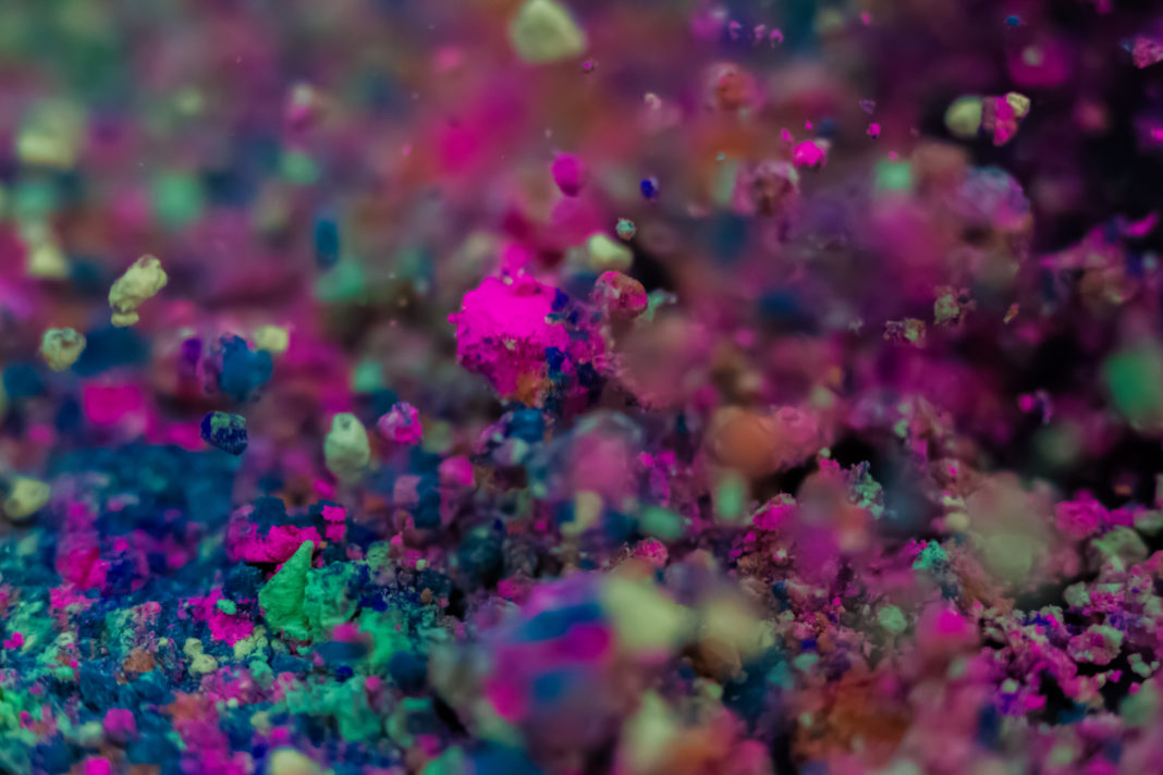 Close up view of colorful powder dust mixed and captured in motion with nice art and abstract creative pictures.