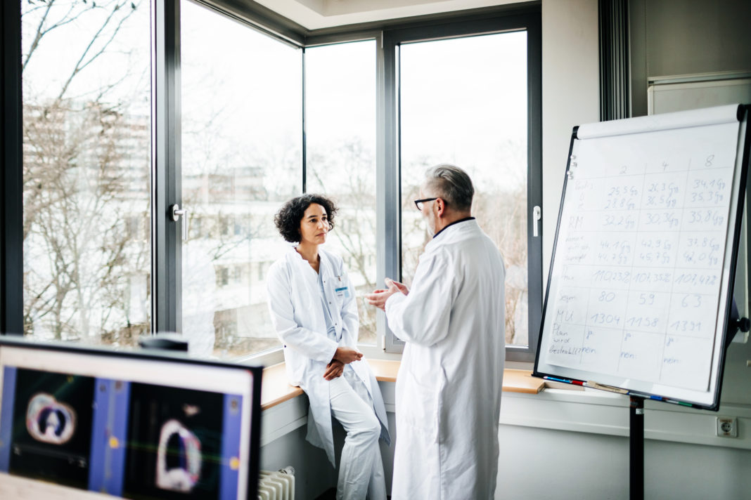 Two Doctors Discussing Test Results In The Lab