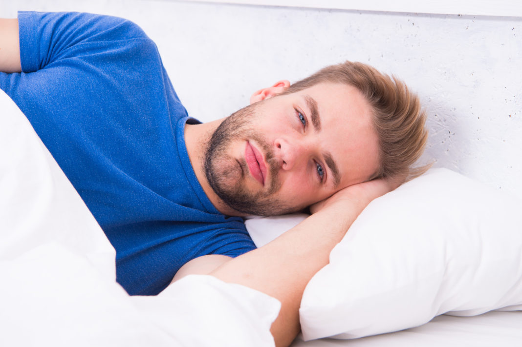 Tips sleeping better. Maintaining consistent circadian rhythm is essential for general health. Man handsome guy sleeping. Get enough amount of sleep every night. Bearded man sleeping face relaxing