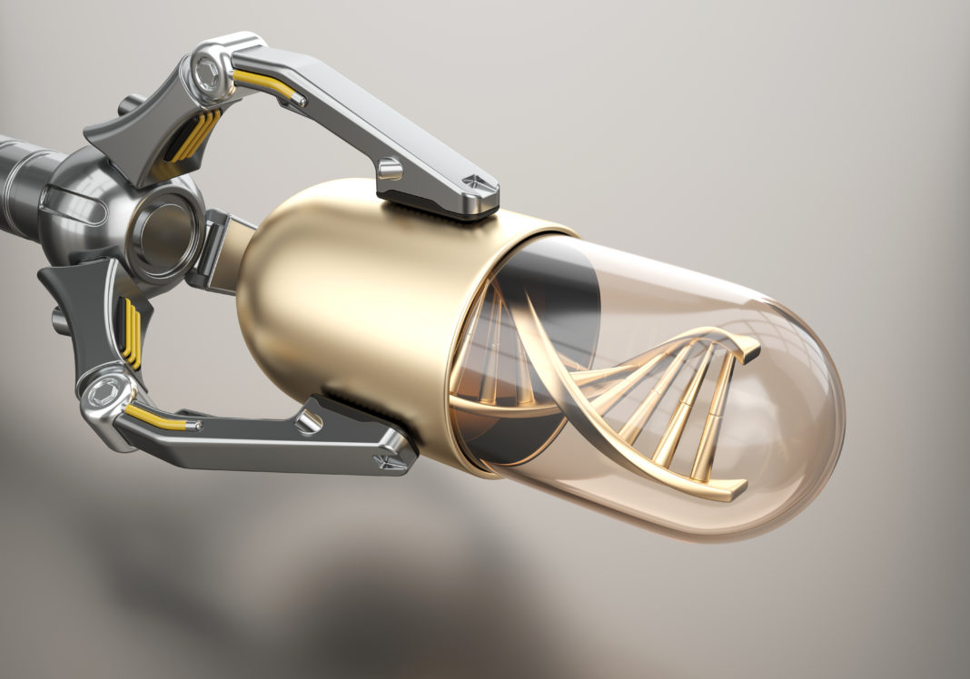 Robotic arm holds golden pill with DNA