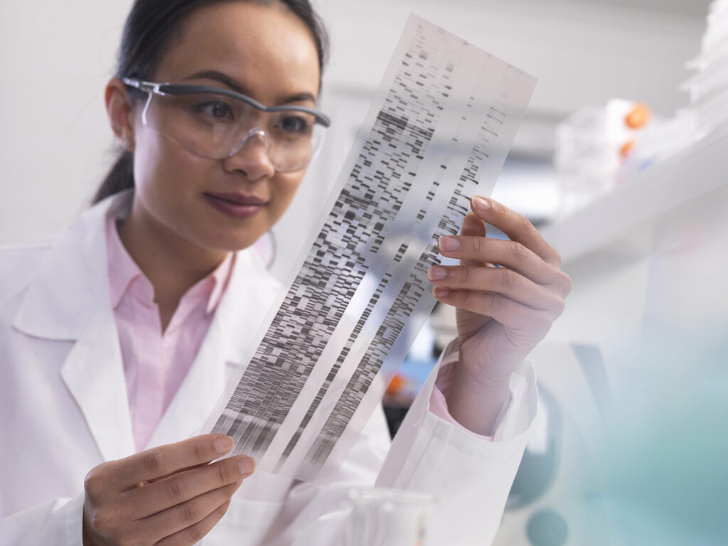 Scientist viewing a DNA profile experiment in a laboratory