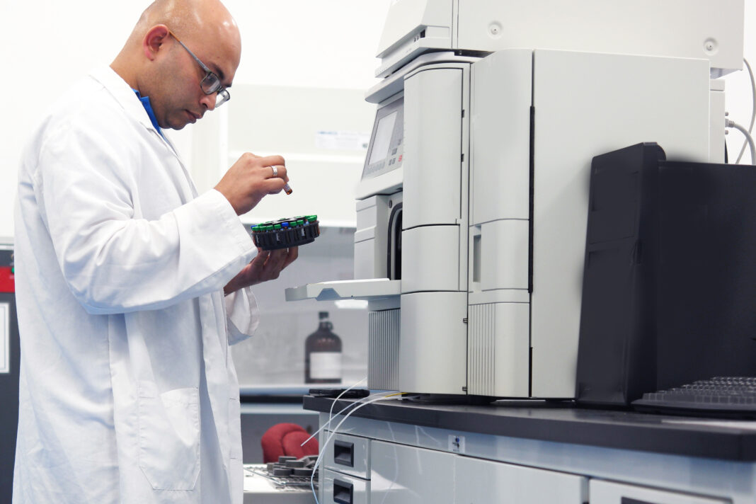 Scientist working with a HPLC